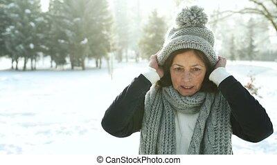 Senior woman in winter nature. - Beautiful senior woman in...