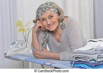 Senior woman ironing