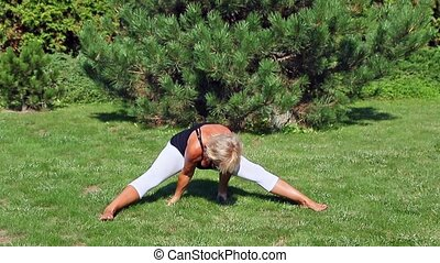 Senior woman is stretching exercising