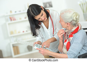 senior woman is visited home by her doctor