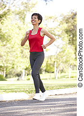 Senior Woman Jogging In Park