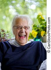 Senior Woman Laughing at the camera.