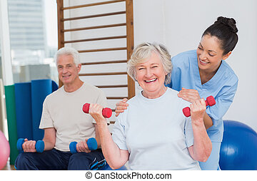 Senior woman lifting dumbbells