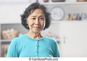 Senior woman looking at camera