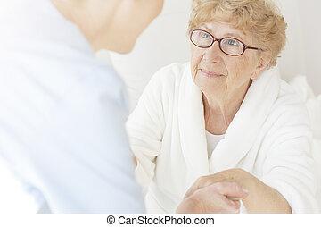 Senior woman looking at caregiver