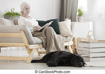 Senior woman looking at dog