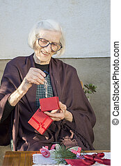 Senior woman looking at her Christmas present