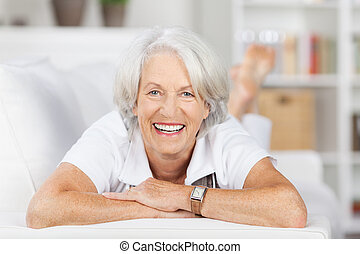 Senior Woman Lying On Sofa