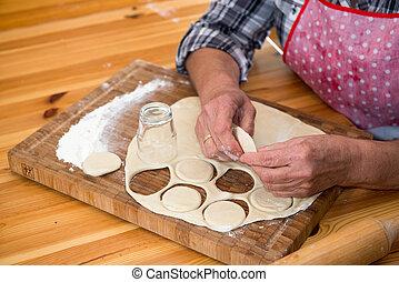 senior woman making cookies