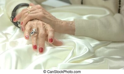 Senior woman manicured hands with jewelry. Old aristocratic...