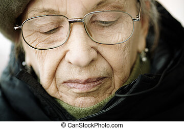 senior woman - older woman with eyeglasses, natural light,...