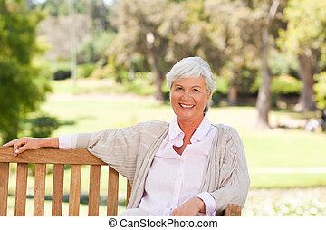 Senior woman on a bench