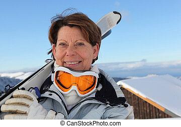 senior woman on a ski vacation