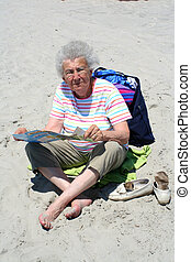 Senior Woman on Beach Reading