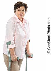 senior woman on crutches