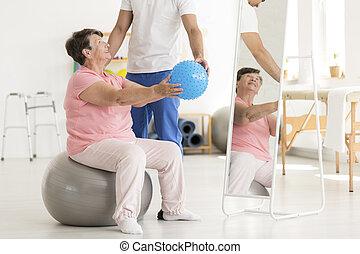 Senior woman on exercise ball