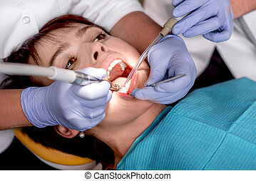 Senior woman on the dental operation.