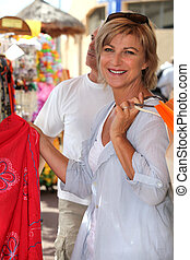 senior woman on vacation shopping