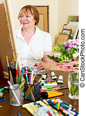senior woman painting picture