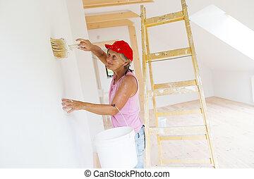 Senior woman painting