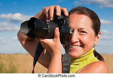 Senior woman photographer
