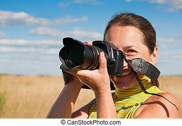 woman photographer with camera