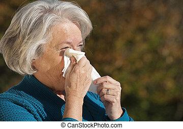 Senior woman having flu