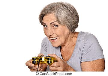 Senior woman play video game