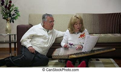 Senior woman playing instrument