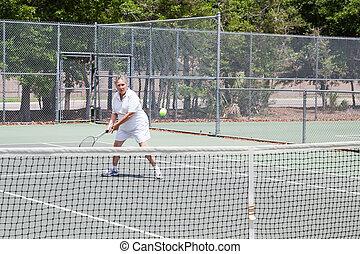 Senior Woman Plays Tennis