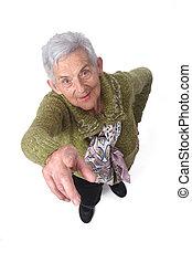 senior woman pointing on white background