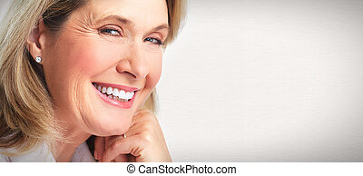 Senior woman portrait. - Senior smiling woman portrait. Over...