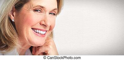 Senior woman portrait. - Senior smiling woman portrait. Over...