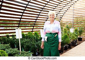 Senior Woman Posing in Garden