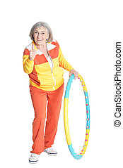 Senior woman posing with hoop and showing thumbs up