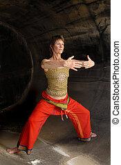 Senior Woman Power Qi - Woman in Asian Yoga Qigong...