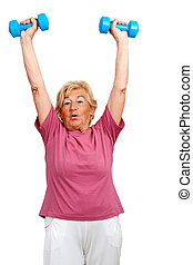 Senior woman raising arms with weights.