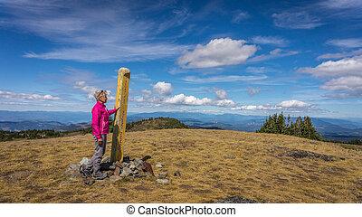 Senior Woman reaching the summit