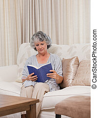 Senior woman reading her book