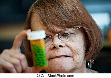Senior woman reading instructions on prescription