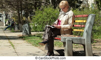 Senior Woman Reading Magazine
