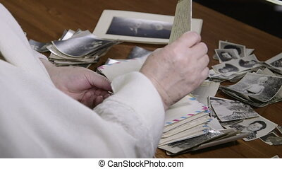 Senior woman reading old letters