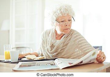 Senior Woman Reading the Morning News