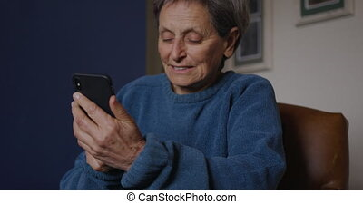 Senior woman relaxing alone at home
