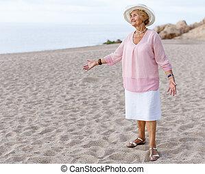 Senior woman relaxing at seaside
