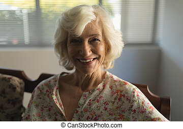 Senior woman relaxing in living room at home