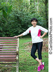 Senior woman relaxing on park bench