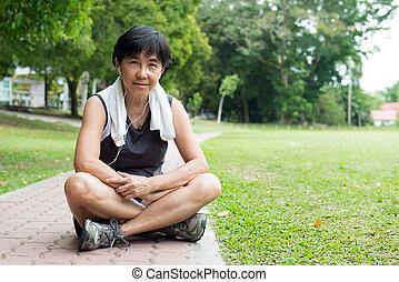 Senior woman resting after jogging