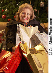 Senior Woman Returning After Christmas Shopping Trip