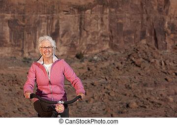 Senior Woman Riding A Bile